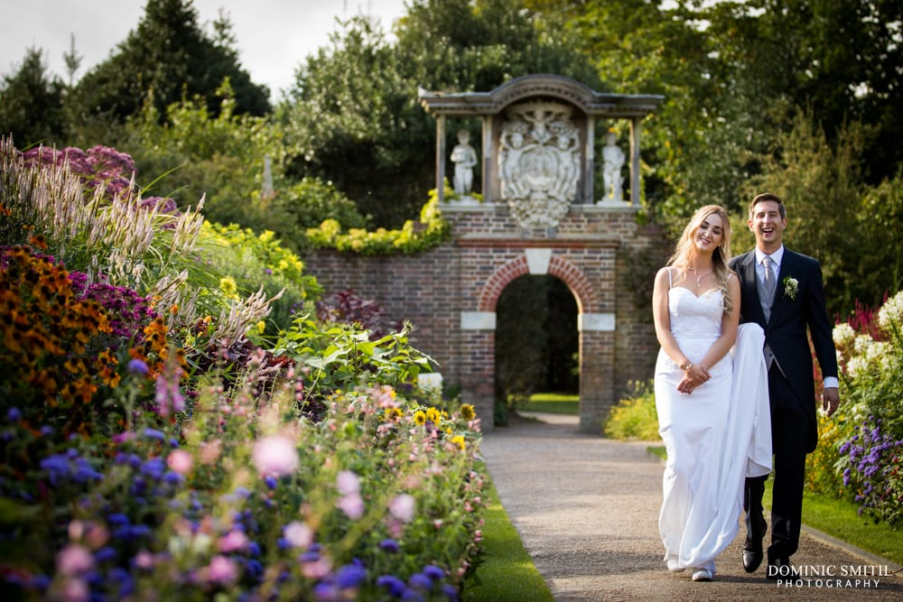 Wedding photo taken walking through the gardens at Nymans