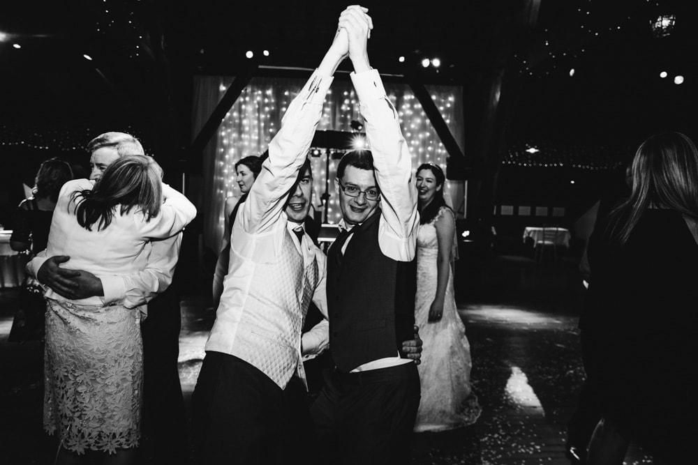 groom and bestman dancing