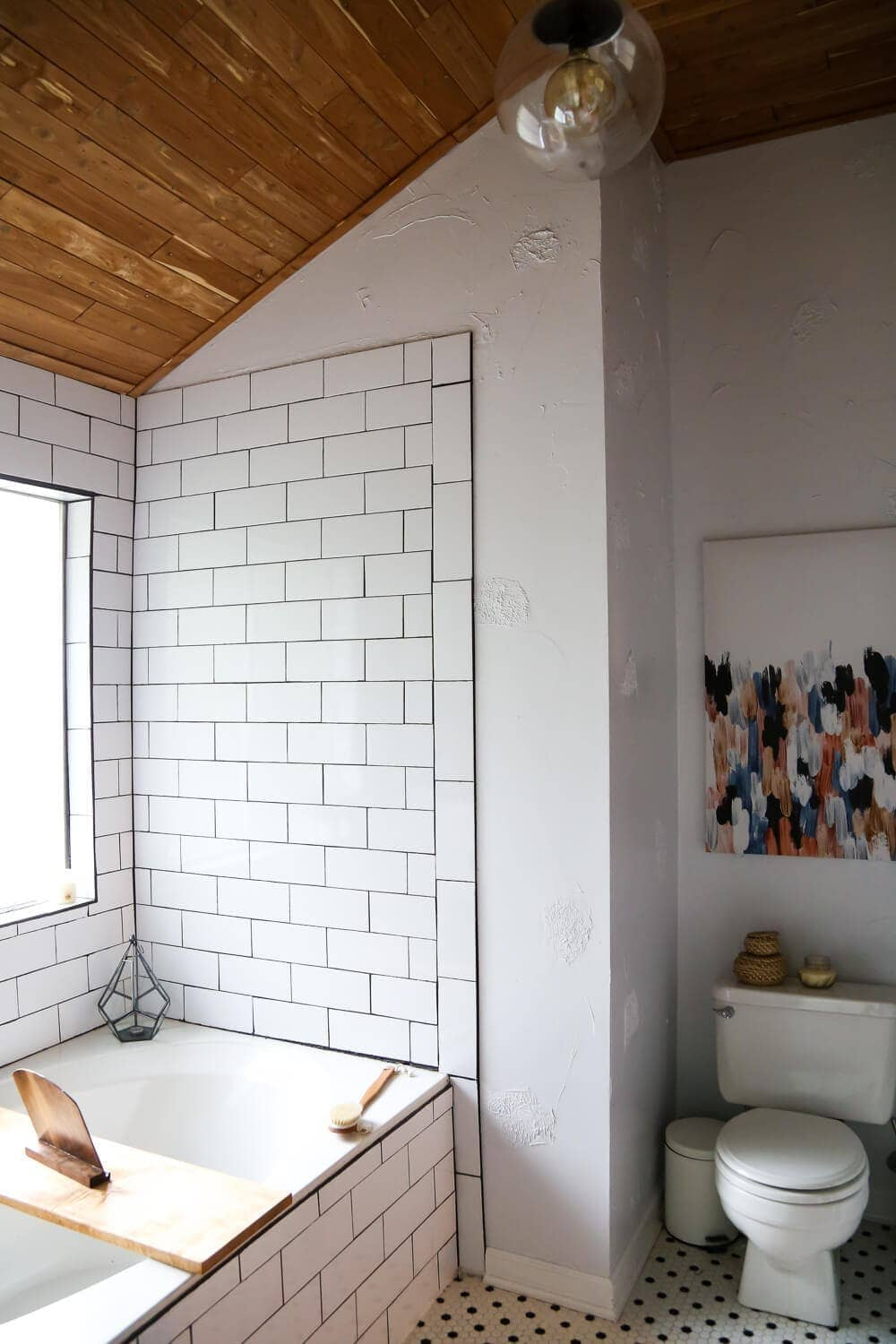 Master bathroom renovation with white subway tile and cedar planked ceiling