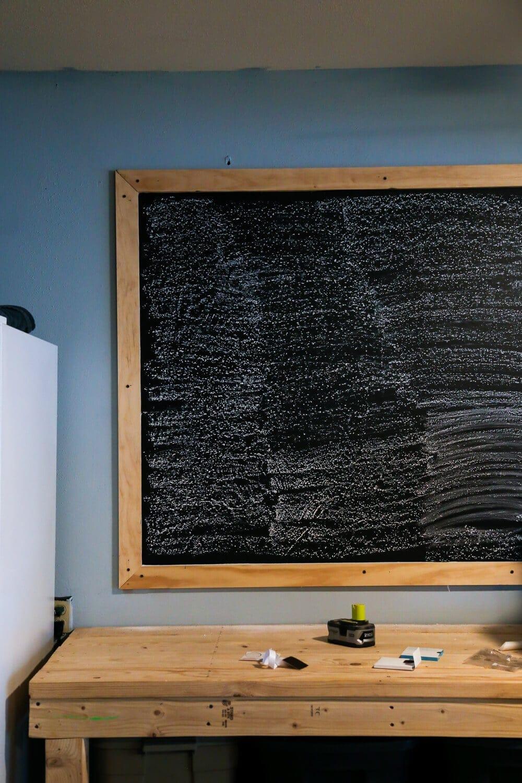Prepping DIY chalkboard for use