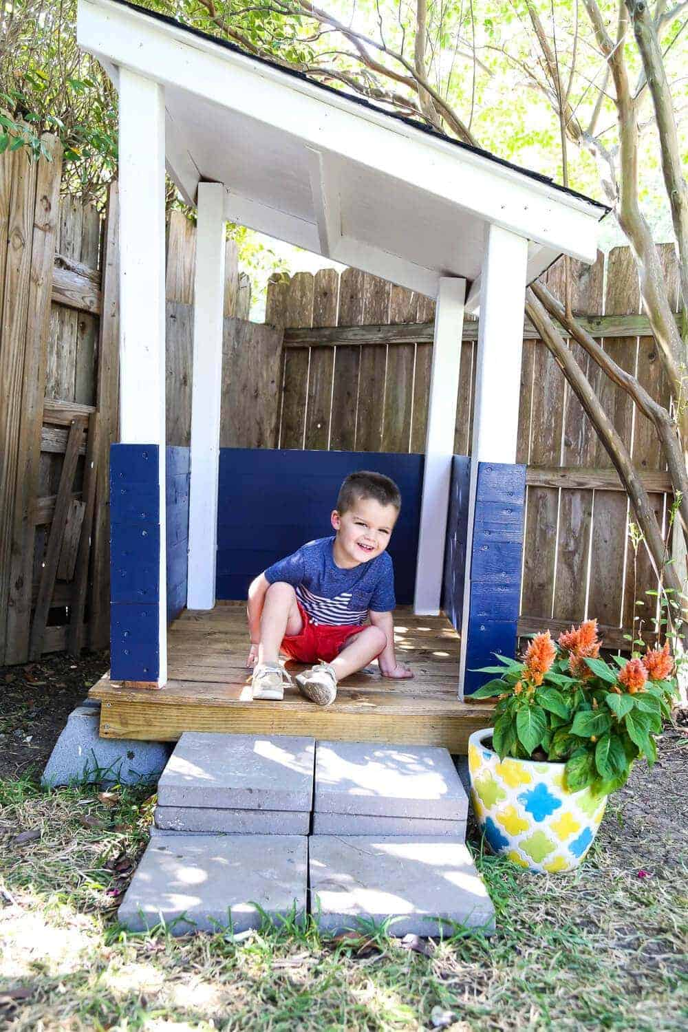 Toddler in DIY playhouse