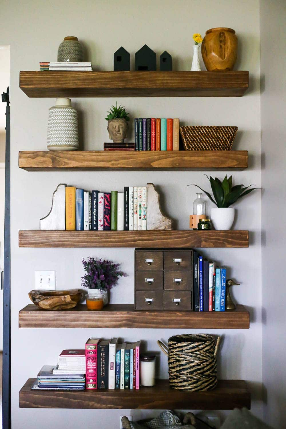 wall with floating shelves