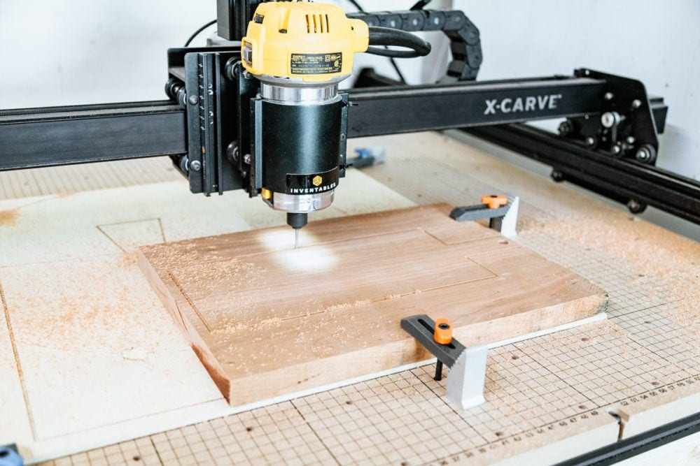 close up of X-Carve 3-d carving machine cutting out a small cutting board
