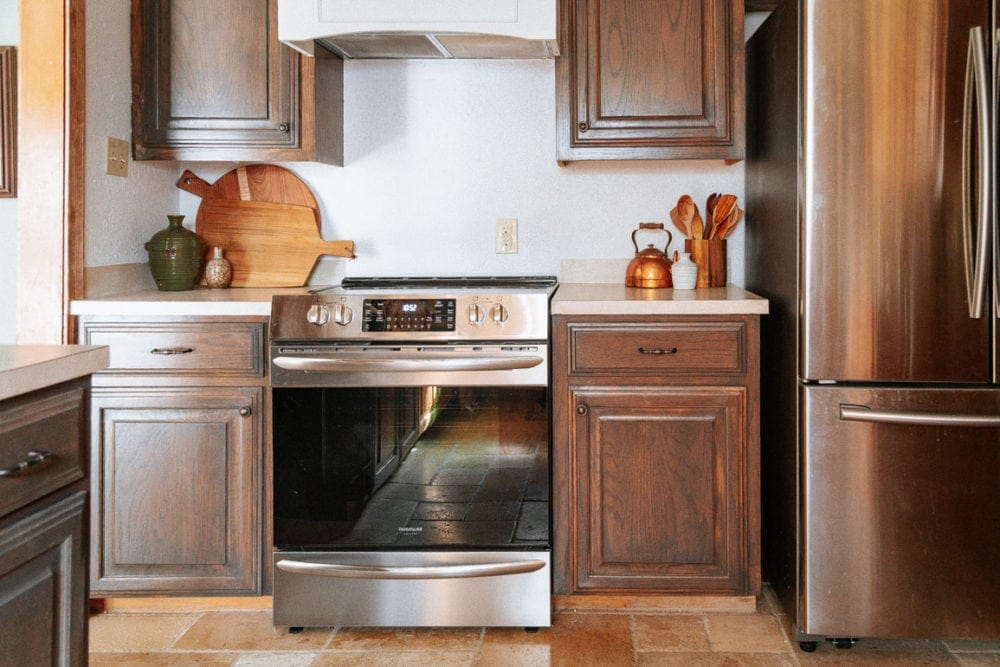 kitchen with dark brown cabinetry and a Frigidaire gallery range