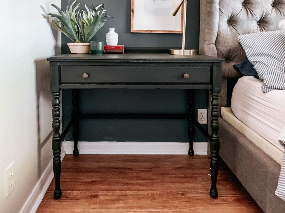 small vintage desk that has been painted black