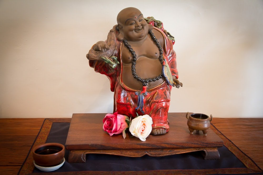 Budai, the laughing Buddha with a cup of tea