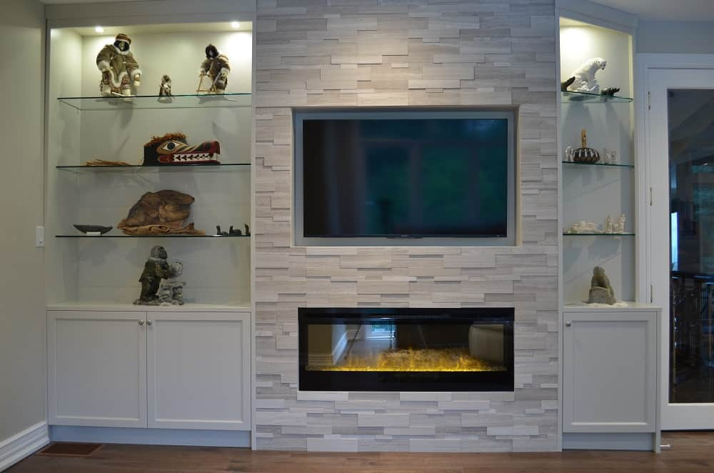 CUSTOM WALL UNIT ~ Dimplex BLF50 set into wall of Erthcoverings Silver Fox stone with custom cabinetry on the sides