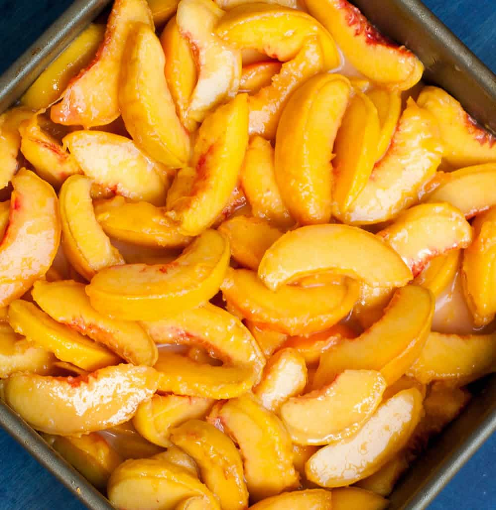 Georgia Peach Cobbler. Fresh peaches, lightly spiced and sweetened with two kinds of sugar, are baked under a delicious sweet biscuit topping!