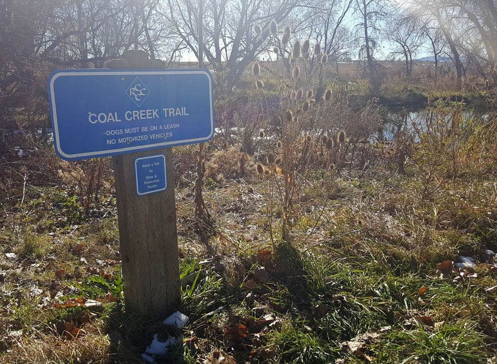 Coal Creek Trail sign along the river