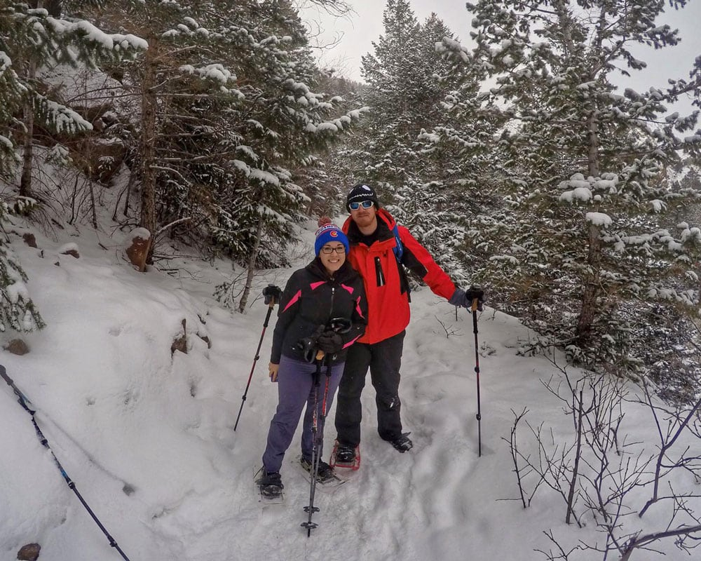 Snowshoeing on a snow packed trail in all of our winter essentail