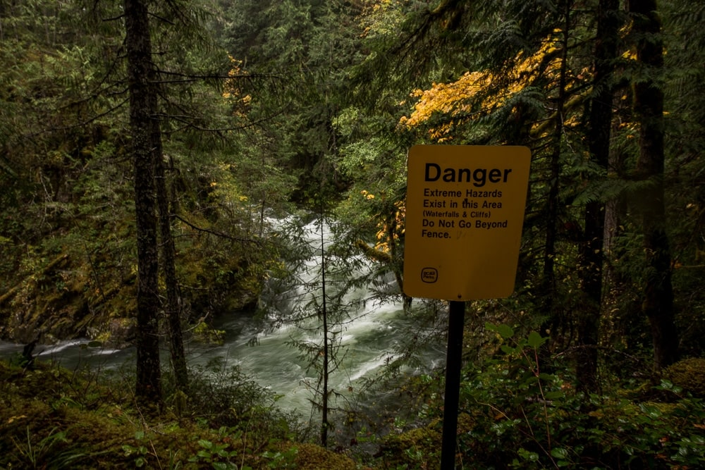 Danger sign warning of extreme hazards next to Little Qualicum Falls