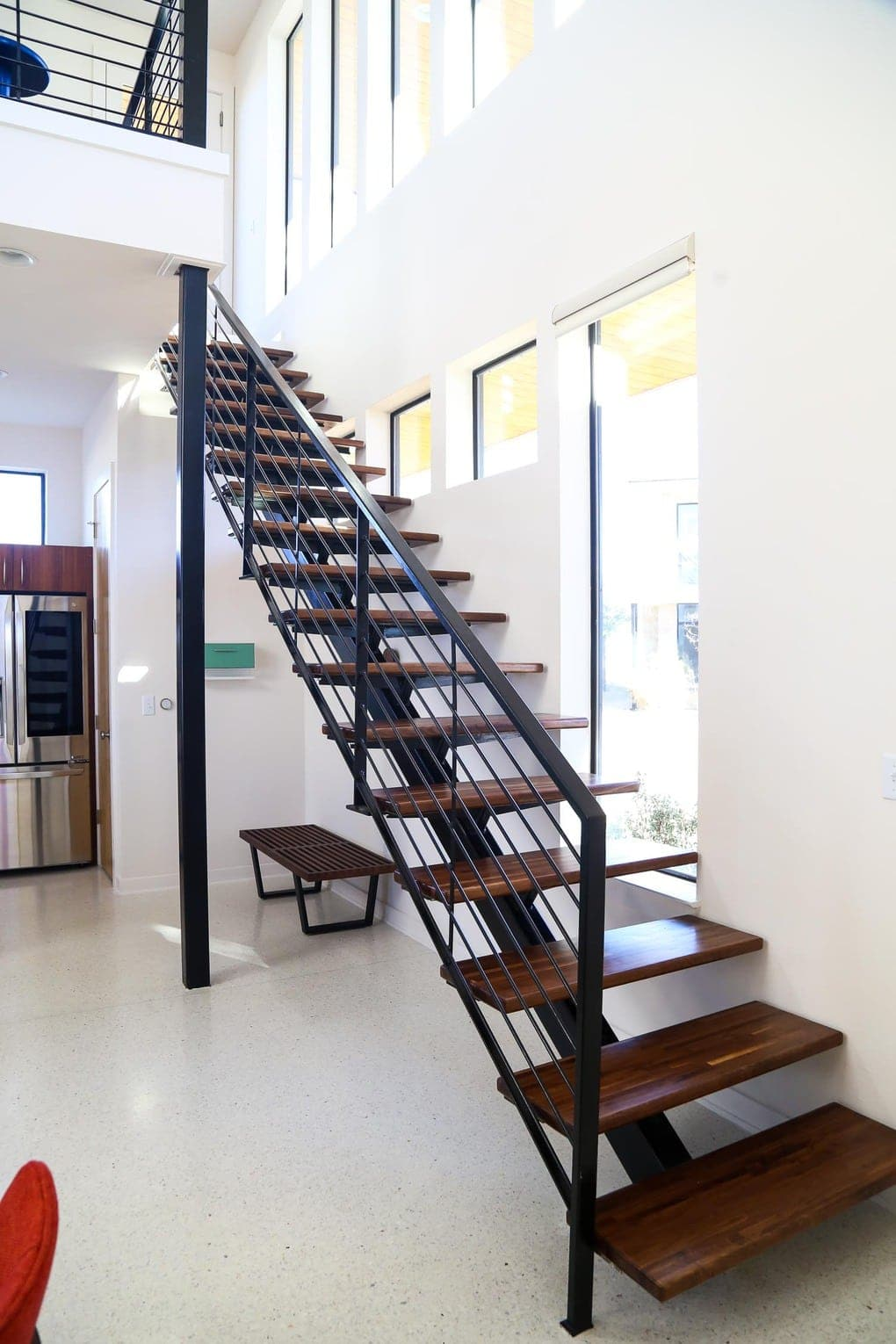 Gorgeous open staircase with midcentury modern design
