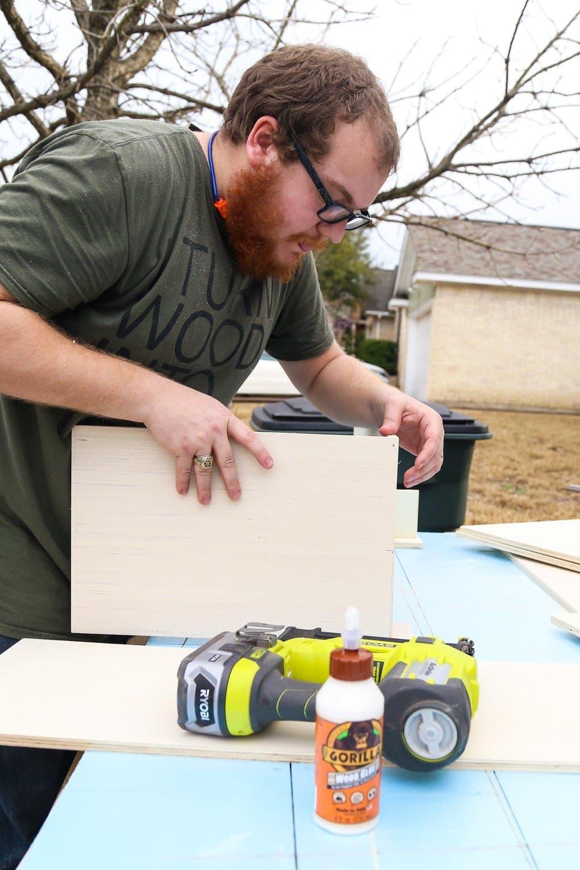 Man building a plywood box