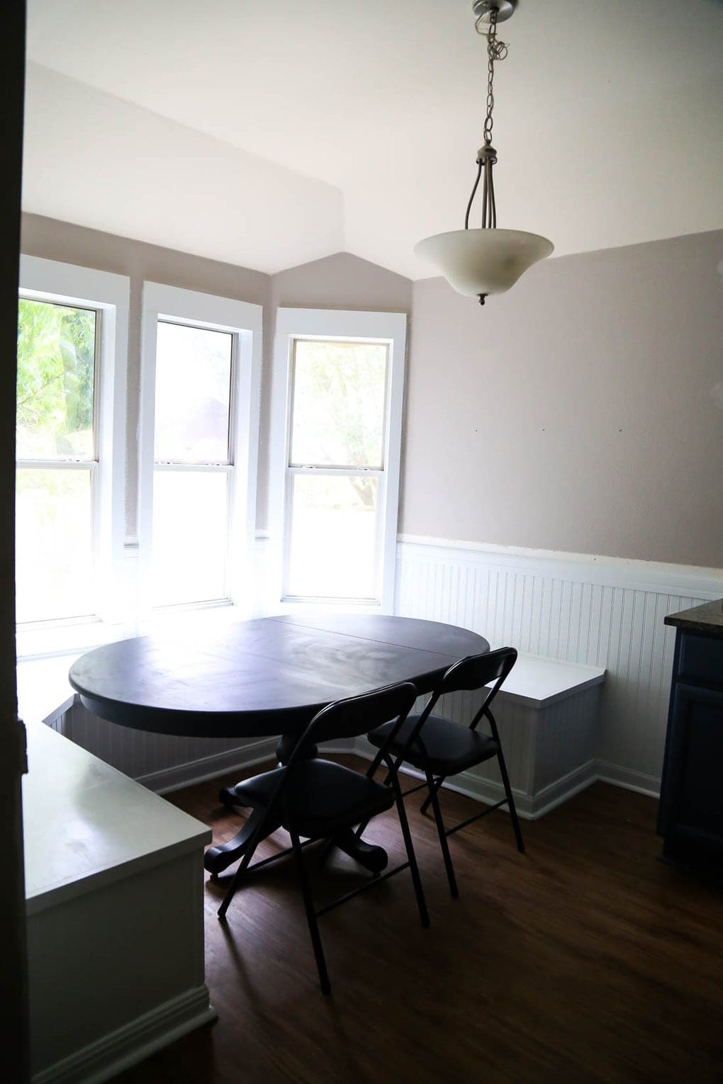 Banquette and beadboard in dining room