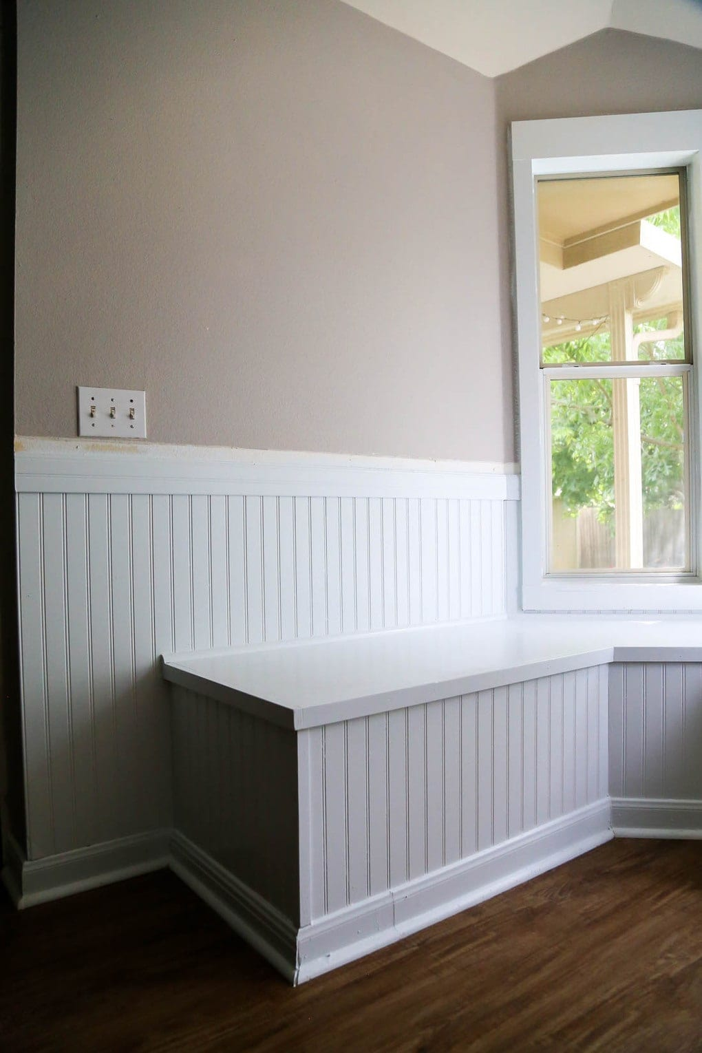 Banquette with beadboard on walls