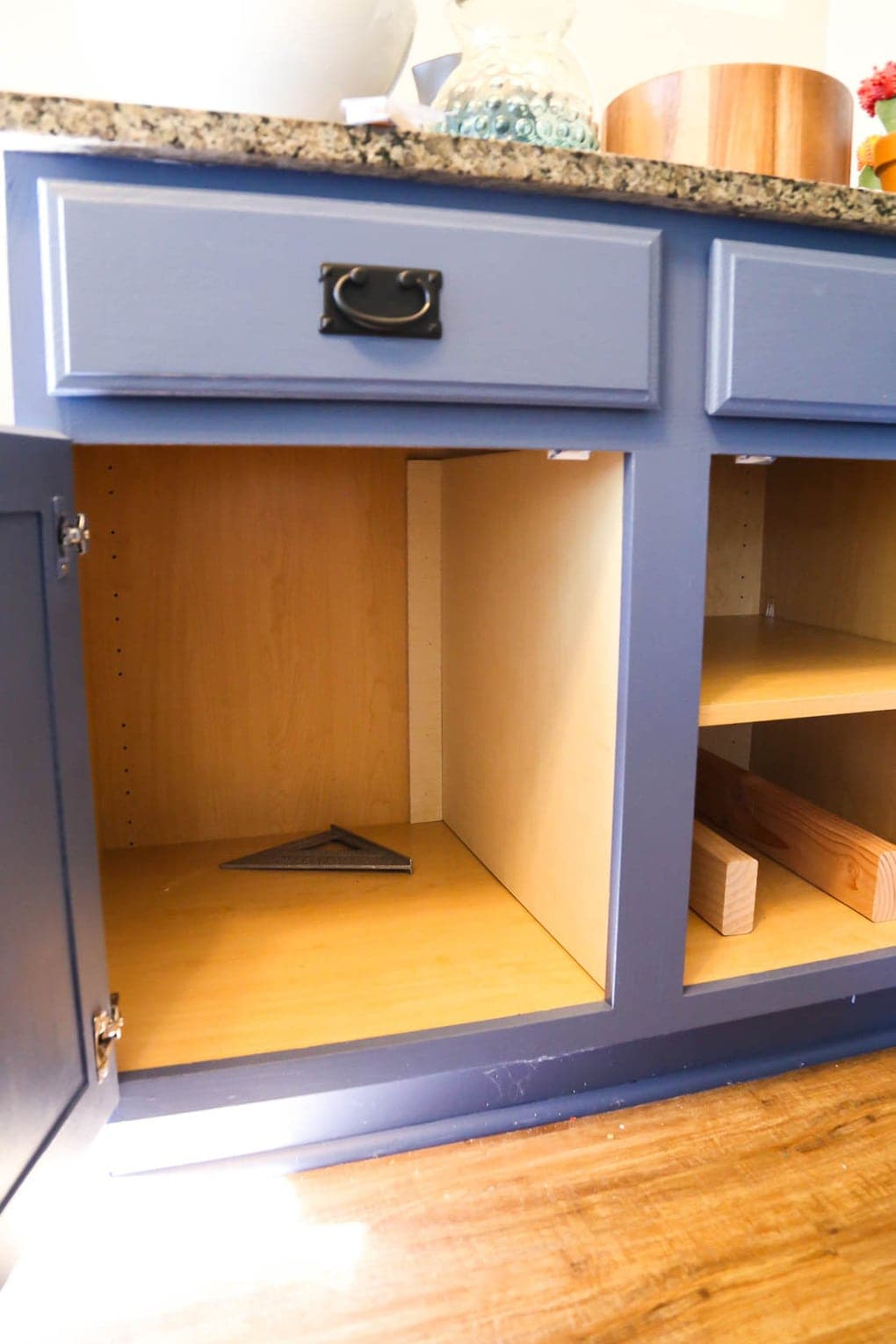 Cabinet with a hidden trash can