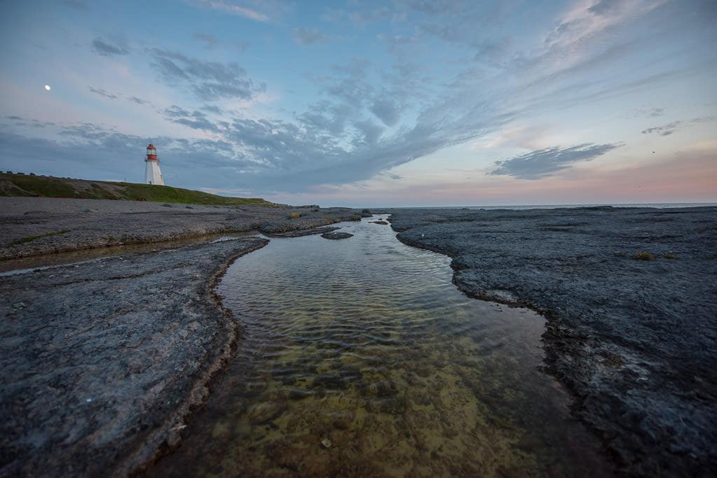 Point Riche Lighthouse and a Tide Pool shortly before sunset