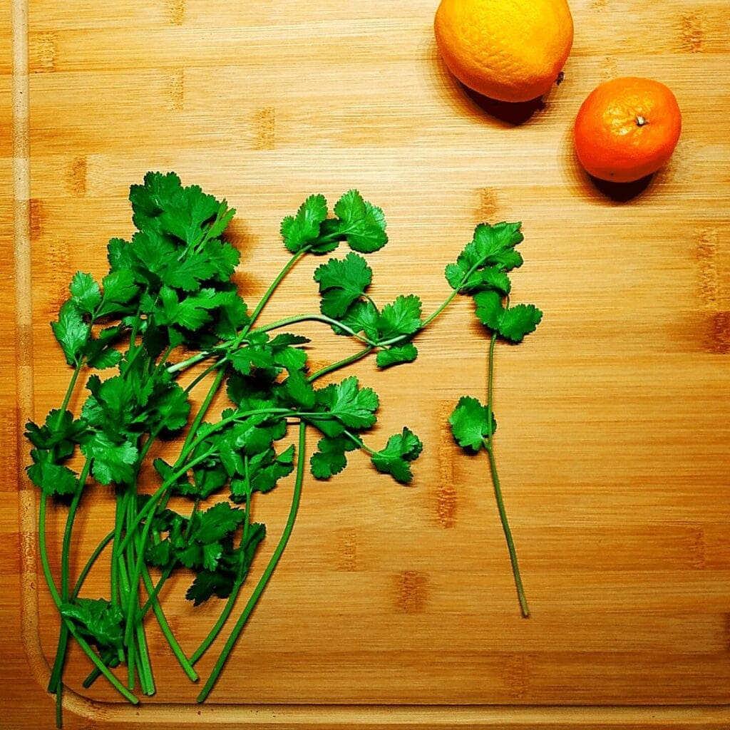 Fresh Cilantro as pictured adds a lot of flavor to foods.