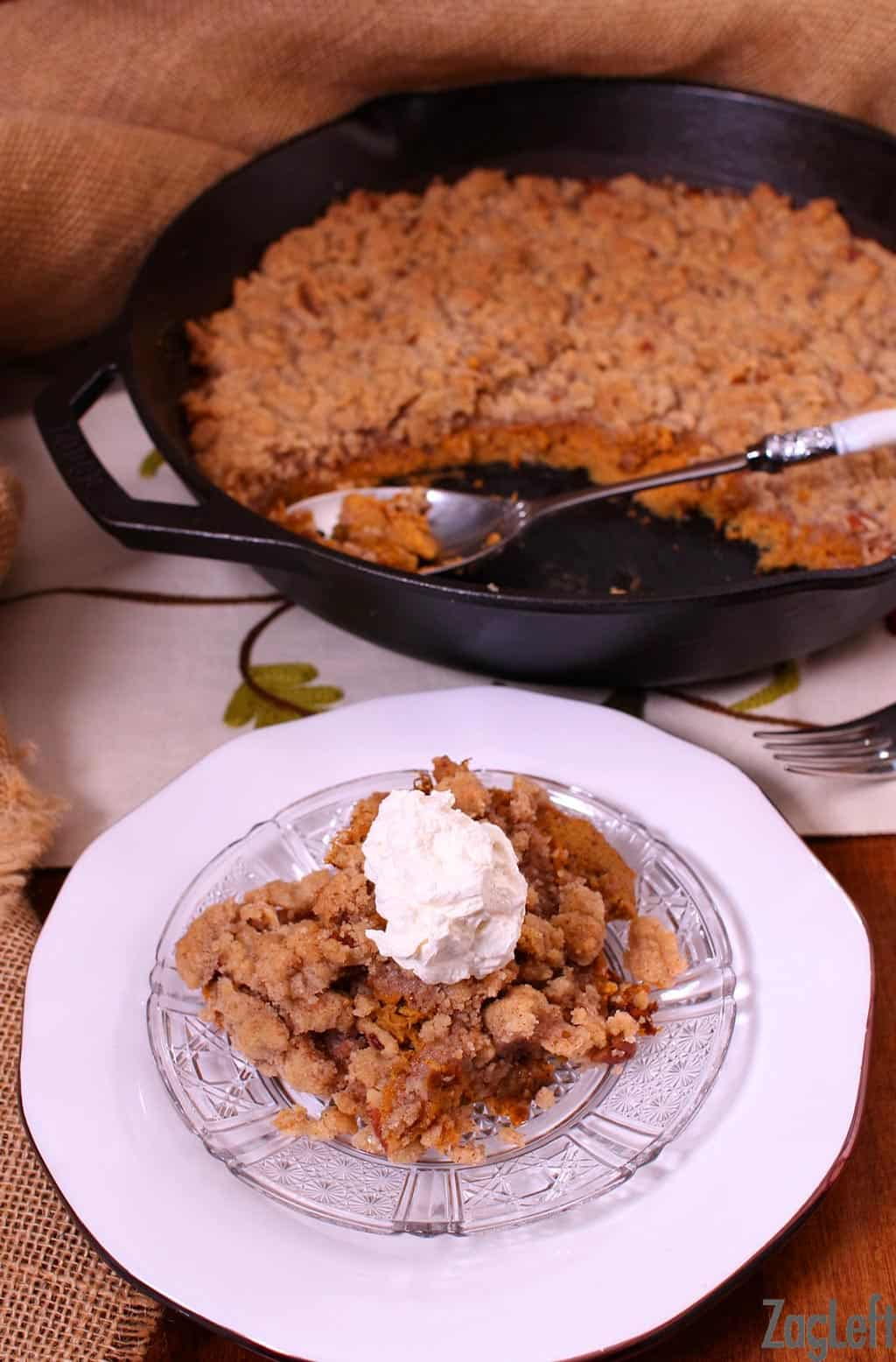 This Skillet Crustless Pumpkin Pie with streusel topping has all the wonderful flavors you would expect in a traditional pumpkin pie. It's baked in a skillet without the crust, then topped with a buttery, spiced streusel topping. | www.zagleft.com