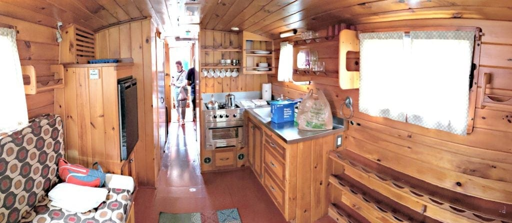 canal boat trips - Interior of Erie Canal Packet Boat galley (Kitchen) with knotty pine walls