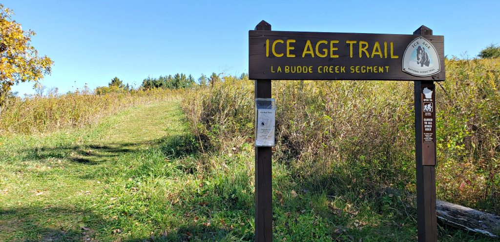 sign reading in part: Ice Age Trail La Budde Creek Segment on the Wisconsin Way pilgrimage