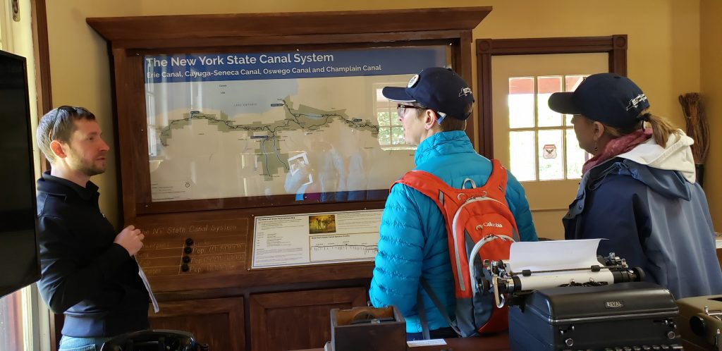 Canallers looking at map in Spencerport Depot and Museum