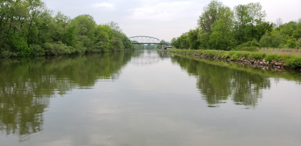 Misty view of Erie Canal with bridge far on horizon