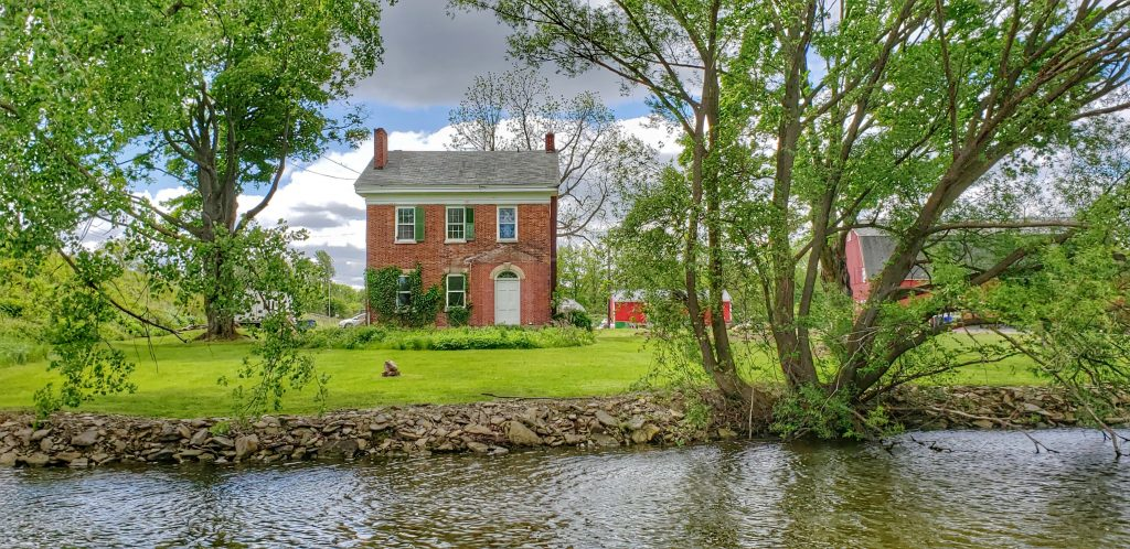 New England style brick farmhouse at the Erie Canal