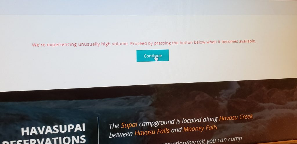 Photo of computer screen with Havasupai Reservations message: We're experiencing high volume