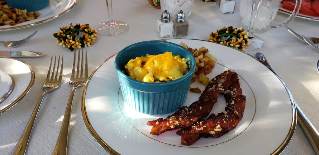 Bacon, eggs and potatos on grand china at Asheville B&B near Biltmore