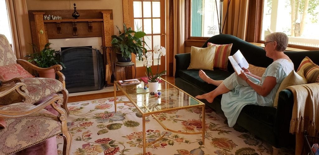 UNSTPPABLE Stacey reclines in elegant parlor of one of Asheville NC B&Bs