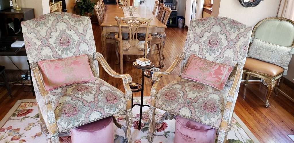 Sophisticated fabric and colors are integrated into tow arm chairs with elegant pink footstools at Cumberland Falls Bed and Breakfast