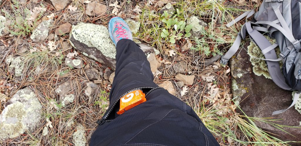 Granola bar in front thigh pocket of KÜHL rain pants