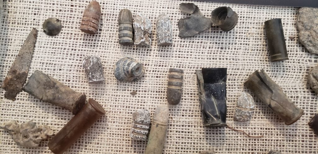 Bullets and casings unearthed at Powder River Battlefield in display case