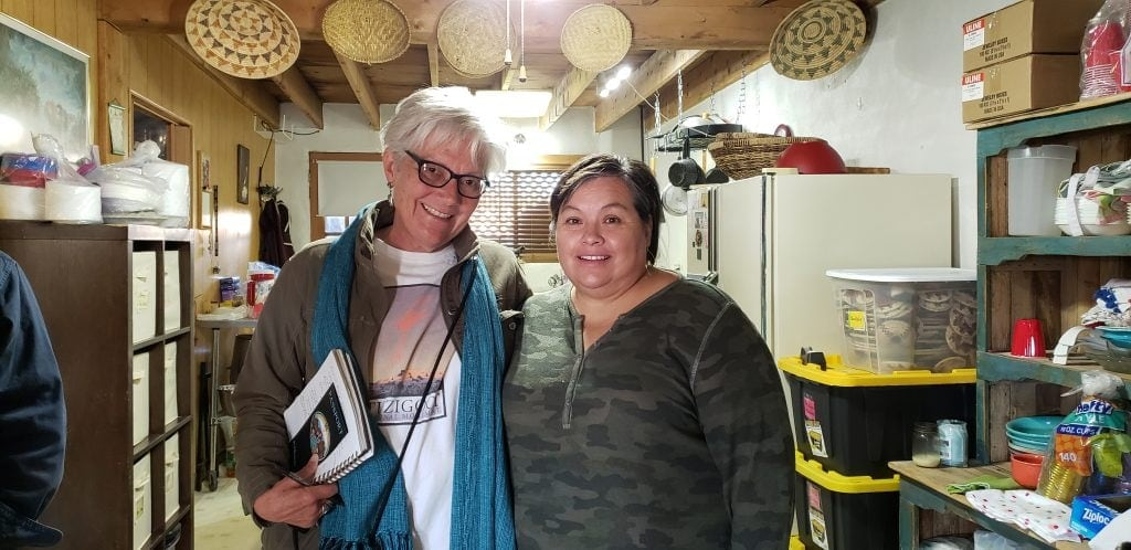 Stacey Wittig and Deb Torres stand together in Deb's kitchen at San Idefonso Pueblo