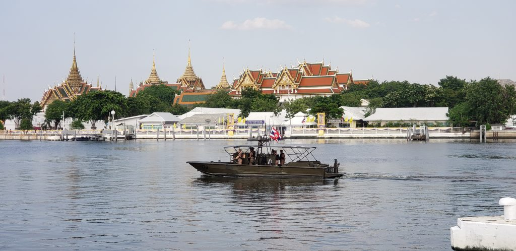 Patrol boat does a security sweep prior to the Royal Barge Processional