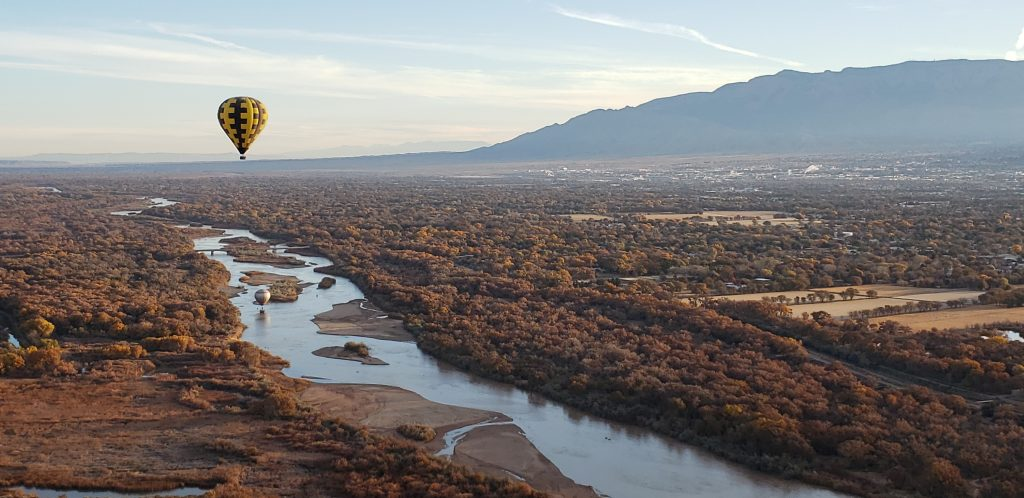 Aerial view of Albuquerque with Rio Grande River below and Sandia Mountains in the background. I took this photo for the Ultimate Guide to Albuquerque from a balloon.