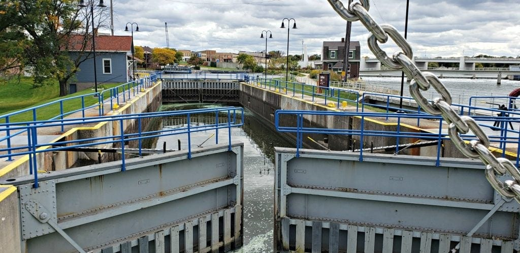huge gray metal doors sit partially opened to the lock at De Pere Riverwalk, one of the things to do in Green Bay WI