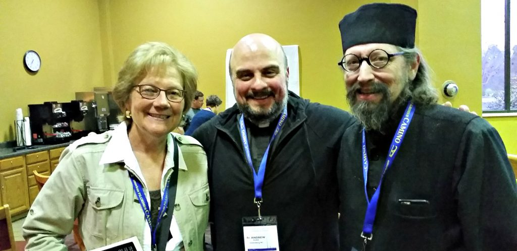 UNSTOPPABLE Stacey stands with two men with conference name tags around their necks - Tall man on right is Fr moses from Holy Resurrection monastery