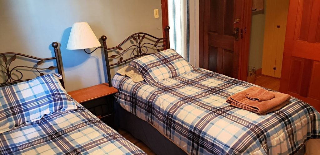 twin beds with night stand and lamp between