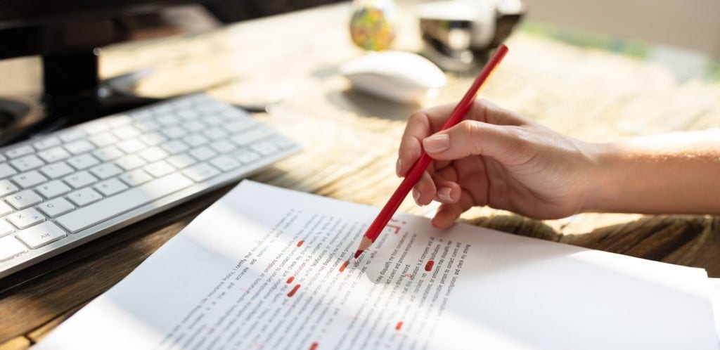 freelance editor reviewing a document