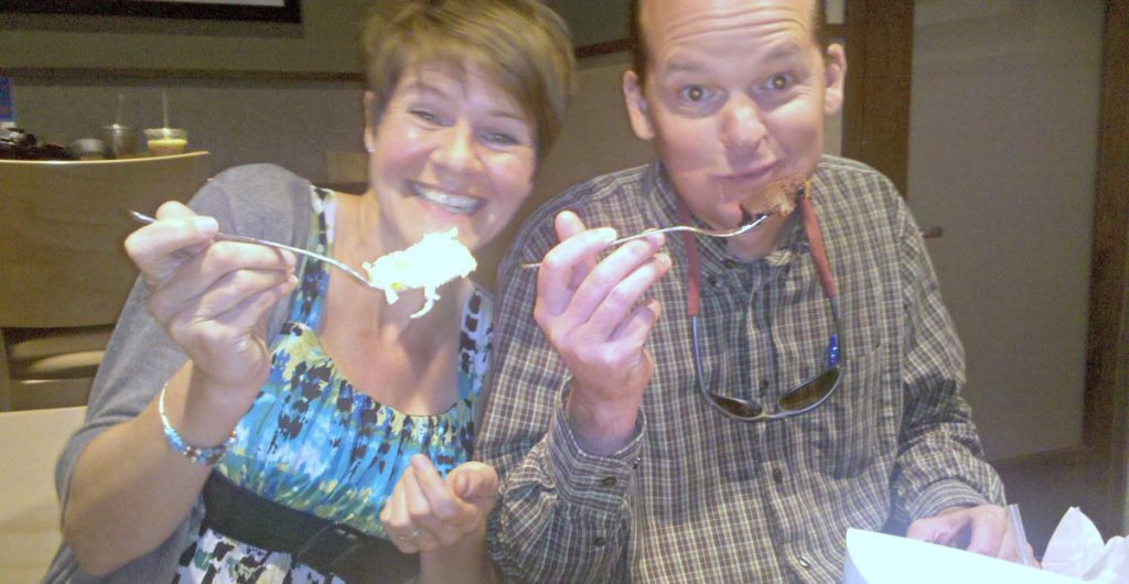 Two tasters smile as they sample Wildflower Bread Company wares
