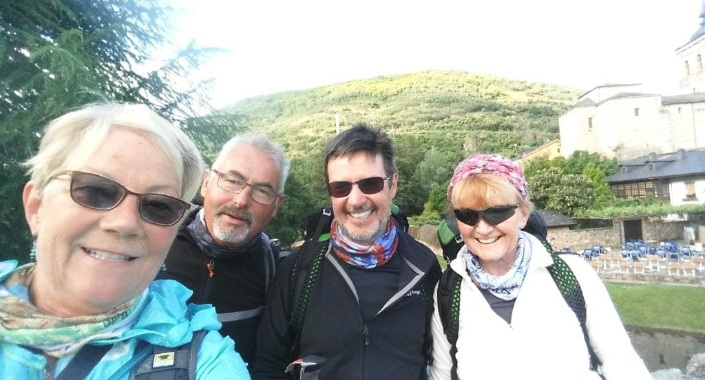 a selfie of author and three other hikers on the Camino de SAntiago, one suggestion for