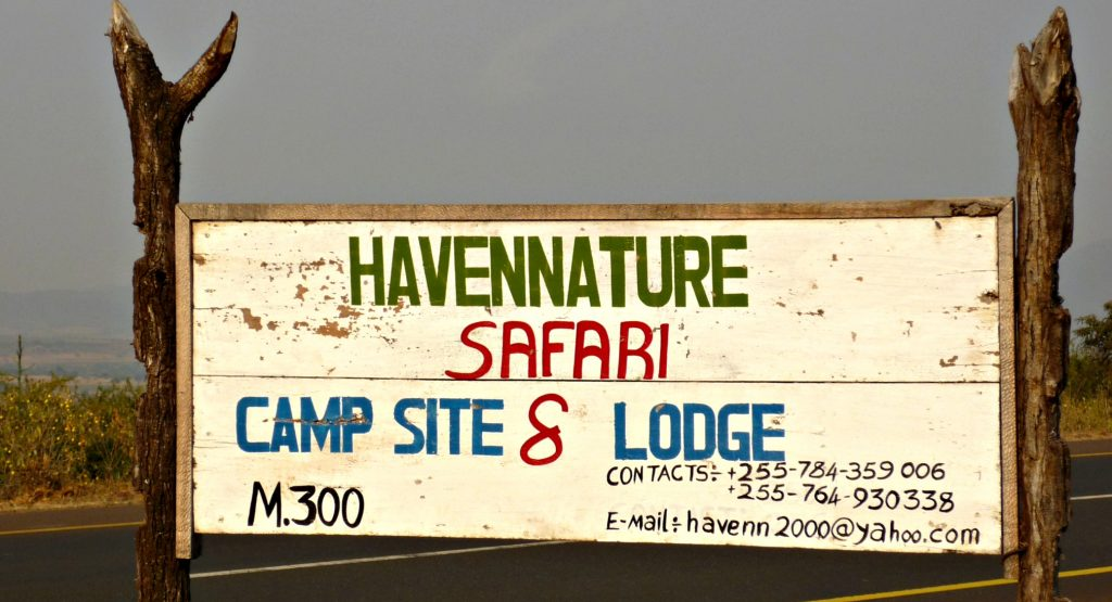 Rustic sign reading Havennature Safari Camp & Lodge
