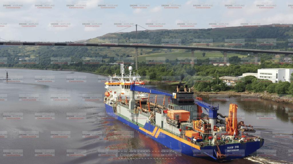 Dredger sailing down the Clyde at Erskine Bridge, Scotland