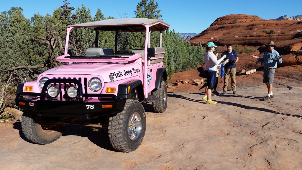 Pink Jeep parked on Sedona Red Rocks