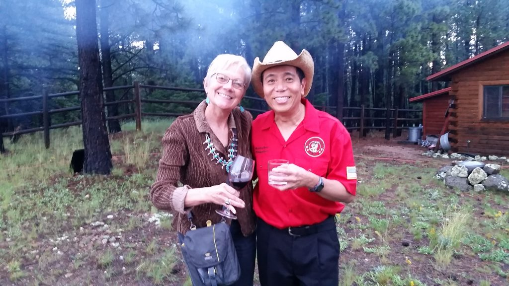 Blogger UNSTOPPABLE Stacey with Harry Soo outdoors with smoke rising from campfire