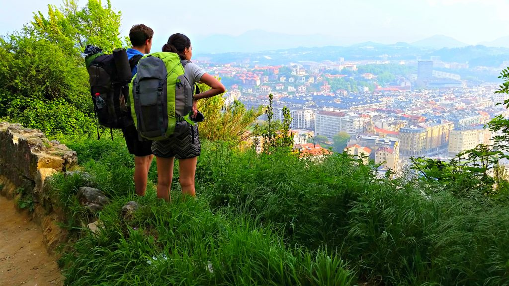 Two young backpackers overlook San Sebastian from the hills east of the coastal town