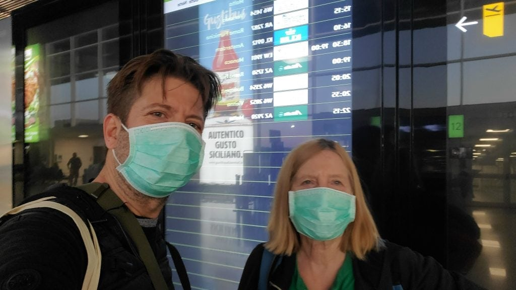 Jason and CArla Rupp in airport with medical masks