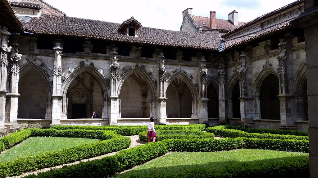 Very green garden of the medieval cloister at the Cahors Cathedral in southwestern France is evidence of lots of rain and moisture.